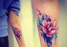 Forearm Watercolor Magnolia Tattoo