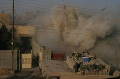 Marine Corps Abrams tank fires its main gun into a building to provide suppressive fire against insurgents who fired on other U. Marines during a firefight in Fallujah, Al Anbar province, Iraq, Dec. Military Jokes, Army Humor, Military Life, Military History, Anime Military, Military Weapons, Army Quotes, Iraq War, Military Pictures