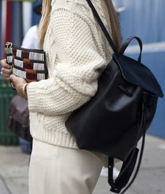 Every gal should have a simple but elegant leather backpack in their wardrobe. This one was spotted around New York Fashion Week. #handbag #fashion #handbags