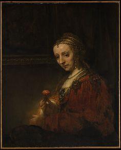 Woman with a Pink  Rembrandt (Rembrandt van Rijn)