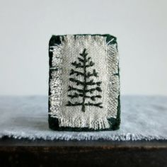 Items similar to Evergreen Tree Hand Embroidered Brooch - Winter Coat Accessory - Jewelry Brooch on Etsy Textile Jewelry, Fabric Jewelry, Textile Art, Jewelry Art, Jewelry Accessories, Embroidery Stitches, Hand Embroidery, Fabric Brooch, Damier