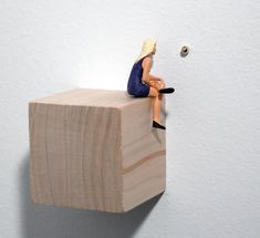 To see Gold (2004), 2 x 3 x 2 ¼, Resin figurine on wooden base and golden sphere on wall