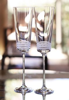 "Lalique Facet Champagne Flute   $160.00 each 	10"" 		  Item# 1594300  Whether around the bar or invited to your table, the "" Facet"" glasses combine aesthetics to functionality. Their pattern of sober and ultra-contemporary lines magnify the brightness of crystal."