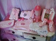 Royal Princess: Onesie, bib, blanket, diaper cover, princess picture frame, sip and munch cup, socks, 3 wash cloths, pacifier clips, 2 hair bows