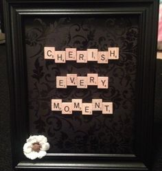 "I made this for my mama's birthday present. Scrabble is really big in our family and for our situation ""cherish every moment"" was a very fitting quote. I just bought scrapbook paper and the flower from a craft store and the frame for 3 bucks from walmart. #scrabble #craft"