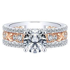 18K Rose and White Gold Stacked Vintage Style Diamond Engagement Ring. This ring features .73cttw of round diamonds with an ornate 3-band stacked style of rose and white gold with a floral center desi