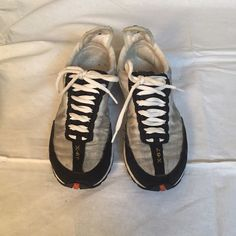 White and Black Polo sneakers. White, Black, and Gray Polo Sneakers. Has some wear but overall good condition. Polo by Ralph Lauren Shoes Sneakers