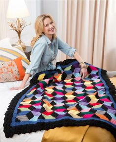 Looking to use up some of your scrap pile and still get a gorgeous crochet afghan? Then check out one of the cooled crochet afghan patterns around, the Contemporary Stash-Busting Blocks Throw. Based on a classic quilt pattern, this outstanding throw creates a colorful optical illusion.