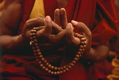 Mandala offering mudra; symbolic of giving an entire universe in gratitude.