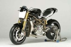 "Custom Ducati motorcycle ""Macchia Nera"". Weighing 293lbs with 185hp, it was built with a Ducati Testrastretta 998R engine. It has parts from Formula 1, MotoGP, and aerospace."