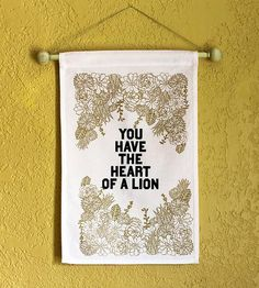 """This """"heart of a lion"""" banner is made with 100% duck cotton. (Includes wooden hanging dowel.)"""
