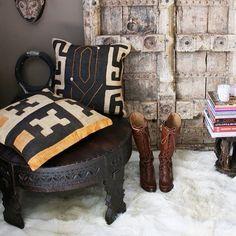 African Kuba cloth pillows and an Indian Chakki table.