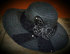 Check out this item in my Etsy shop https://www.etsy.com/listing/103080006/wide-brim-sunhat-black-with-metallic