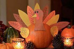 Pumpkin turkey centerpiece - exchange the paper feathers for veggie/cheese kabobs...