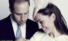 New christening picture of giggling George and adoring mother's gaze