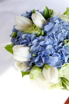 Ocean Blue -  Blue hydrangea, white tulip, green eustoma and white ranunculus  by Lily Sarah #whiteranunculus