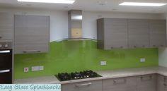 Lime Green coloured glass splashback in a Light Grey Kitchen. Visit easyglasssplashbacks.co.uk to discover more.