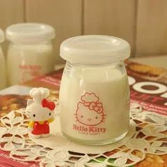 Aliexpress.com : Buy Free Shipping Kawaii Hello Kitty Glasses Milk Bottle/Pudding Bottle/Seasoning Cup Candy Storage Box with Cover Retail from Reliable milk bottle suppliers on House of Novelty $5.49