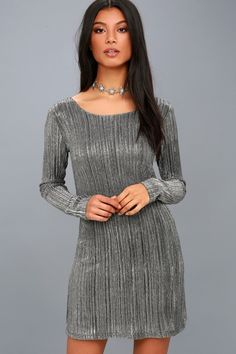 It's always a party in the Amuse Society Shine Bright Black and Silver Long Sleeve Bodycon Dress! Black stretch knit, with shiny silver threading, shapes a bateau neckline and fitted long sleeves. Slinky bodycon silhouette ends at a mini length.