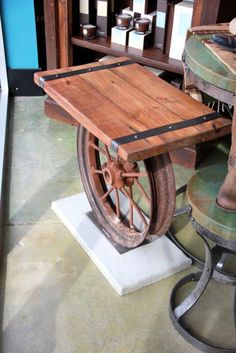 Custom made upcycled wood table from tractor wheel, exclusively Fiddlin Frogs Man Cave Furniture, Car Furniture, Iron Furniture, Custom Made Furniture, Recycled Furniture, Industrial Furniture, Furniture Design, Lifted Chevy, Chevy Trucks