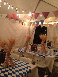 "Love the lights and the ""beer garden"" theme, table settings and table cloths."