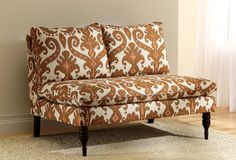Settee. Don't love the fabric, but do love the shape.... I think I could make this!
