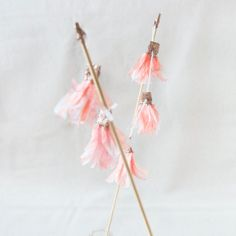 cake topper made with hand dyed (food dye) pink crepe paper tassels dusted in gold glitter. This garland measures 9 inches and is strung with five tassels and a lovely bit of white string. Each post measures 12 inches.