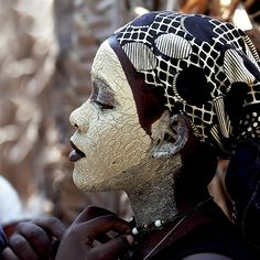 "Portrait of a woman with musiro in Mozambique - ""Some women in Mozambique usually wear a tinted white face mask made from musiro. It's a product made from bark and roots which is ground and mixed with water that protects and softens the skins.""  Photo by KaoBanga    Via Flickr / kaobanga"