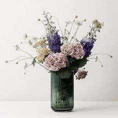 The perfect summer bouquet needs a perfect vase. Currently loving: this green mouth blown glass edition by Danish company Lyngby Porcelain.