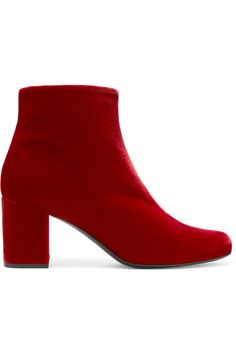 Saint Laurent updates its 'Babies' boots for fall in plush velvet - one of the label's signature fabrics this season. Designed in a sumptuous red hue, this pair has a chic and sturdy three-inch block heel that offers enough height without compromising on comfort. We'll be wearing ours with midi dresses.