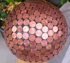 Copper Penny Gazing Ball - DIY bowling ball yard art made with copper pennies - sort of like a traditional gazing ball for your garden but with more bling!