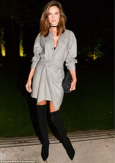 Model mother! Alessandra Ambrosio lead the fashion pack as she put on a leggy display in thigh high boots and a wrap dress at Paris Fashion Week party