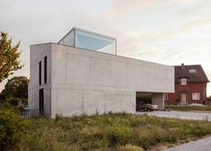 Stark concrete house by ISM Architecten is topped with a glass study.