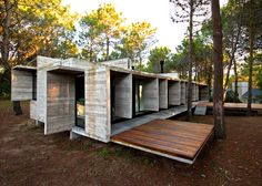 Slabs of board-marked concrete form the walls, floors and roof of this holiday home in a coastal forest