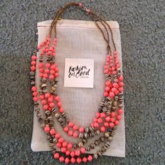 31 bits necklace from Stitch Fix. Coral/pink and multi grey/off-white beads. Perfect condition. Never worn!  With bag and information card. Purchased at $54 from Stitch Fix. Clean and smoke free home. 31 Bits Jewelry Necklaces