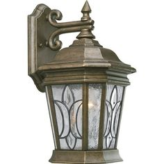 Progress Lighting P5658-86 1-Light Wall Lantern with Tiffany Style Art Glass, Burnished Chestnut by Progress Lighting. $116.28. From the Manufacturer                Durable and stylish die-cast aluminum lantern features beautiful art glass panels in a classic fleur d'lis design. One-light wall lantern with Tiffany style art glass Uses (1) 60-Watt medium base bulb 6-1/2-Inch Width x 12-1/2-Inch Height                                    Product Description            ...