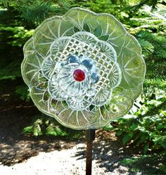 Glass garden art | Bottle Trees, Yard Ornaments, and Related