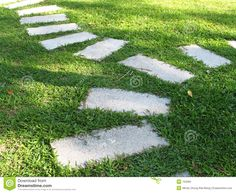 Stepping Stones | Stepping stones laid on a field of green grass.