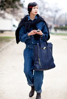 A denim jumpsuit ever looked more put together, with an oversized Phillip Lim bag and sweater insouciantly tied at the neck.