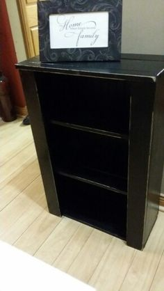 Black distressed shelf with bead board backing