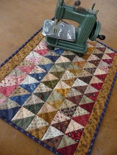 Fine small quilts like these are every bit as much art as a painting to hang on the wall. Beautiful, thank you...