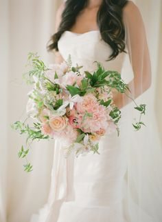 I like greens that add some structure to the bouquet on http://www.stylemepretty.com/collection/2430/