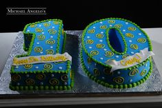 Block 10 #40Milestones  This cake is shaped as the number 10 & iced in colored buttercream.  It is decorated with swirls and polka dots.