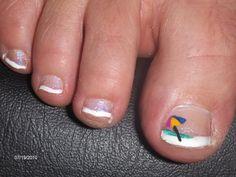 Cute beach umbrella toenail art