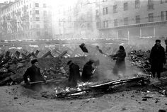 Russian civilians dig anti-tank ditches and warm themselves from the frigid cold with a bonfire anticipating a full-scale German invasion of the Soviet capital during the Battle of Moscow. November 15 1941.