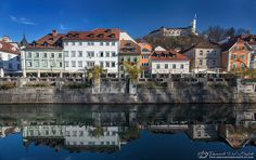 """- The heart of Ljubljana -  Today there is a magnificent sun, walk along the Ljubljanica River that cuts through the old town of Ljubljana, it is the end of November and seems to be spring.The river water calm becomes a gigantic mirror reflecting the small buildings that fill the heart of the city. I hear the violin playing in the distance. In the background there is the Ljubljana Castle, which sits atop Castle Hill south of the city www.emanueledelbufalo.com """"The Long-Term Traveler""""…"""