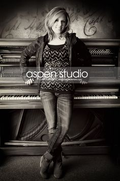 Normally, I think senior pictures with a piano are really awkward and formal, but I like this one a lot. :)