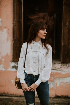 Lovely long-sleeved white blouse with feminine details.