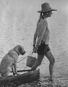 Something about this picture between her outfit, the dog, and the water just makes me smile. :)
