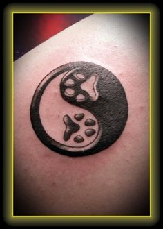 ying yang paw print tattoo  it could be for coco and sugar....the black and white!